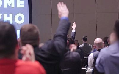 Attendants at the National Policy Institute's annual conference give Nazi salutes as NPI head Richard Spencer speaks of white supremacy, on November 19, 2016 (YouTube screenshot)