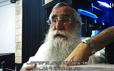 Rabbi Eliyahu Asulin, a certified mohel, telling an undercover reporter that he should practice on babies from low-income families. (Screen capture: Israeli Public Broadcasting Corporation)