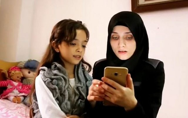 Bana Alabed and her mother tweeting from war-torn Syria. October 7, 2016. (Screen capture: YouTube).