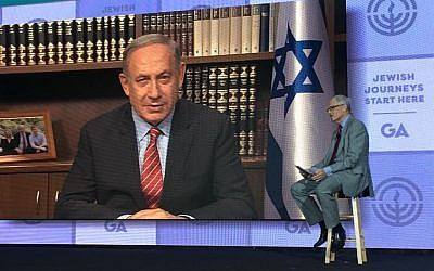 Prime Minister Benjamin Netanyahu, on screen, being interviewed by Richard Sandler at the Jewish Federations of North America's General Assembly, November 15, 2016. (Ron Sachs)