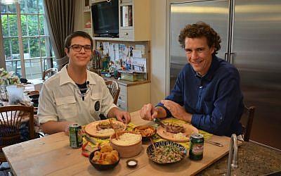 Danny Ashkenazi, left, and Tom Franz preparing to eat filet Osvaldo Aranha in Jerusalem, November 2016. (Courtesy of World Bnei Akiva/via JTA)