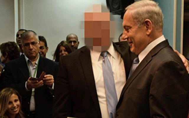 Prime Minister Benjamin Netanyahu with the close associate accused of violence and sexual assault against an artist (Screenshot, Channel 2 News).
