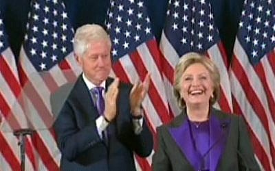 Hillary Clinton, with husband Bill Clinton, giving a concession speech in New York on November 9, 2016. (screen capture: CNN)