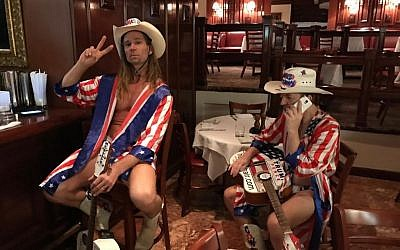 Robert Burck, also known as Naked Man (left), sits with Robert Coffman (right) in Trump Tower on Election Day, Nov. 8, 2016 (Eric Cortellessa/Times of Israel)