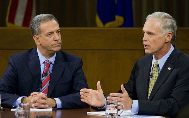 Russ Feingold, left, was defeated in his attempt to take back the Wisconsin Senate seat he lost to Ron Johnson, right, in 2010. (Darren Hauck/Getty Images via JTA)