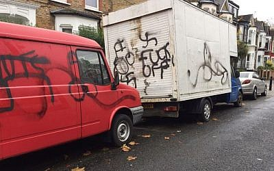 Illustrative -- A truck with the words 'fuck off' and another with swastika graffiti on it were found outside a Jewish school in a Hasidic neighborhood in London, November 14, 2016. (Shomrim N.E. London/Twitter)