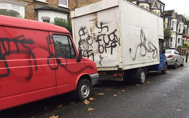 A truck with the words 'fuck off' and another with swastika graffiti on it were found outside a Jewish school in a Hasidic neighborhood in London, November 14, 2016. (Shomrim N.E. London/Twitter)