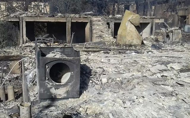The remains of property in the West Bank settlement of Halamish on November 26, 2016, a day after a devastating fire damaged or destroyed dozens of homes (Israel Fire and Rescue Services)