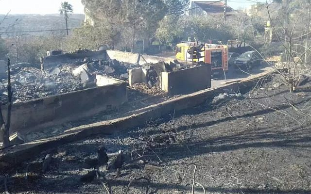 Burned houses in the West Bank settlement of Halamish on November 26, 2016, a day after a devastating fire damaged or destroyed dozens of homes (Israel Fire and Rescue Services)