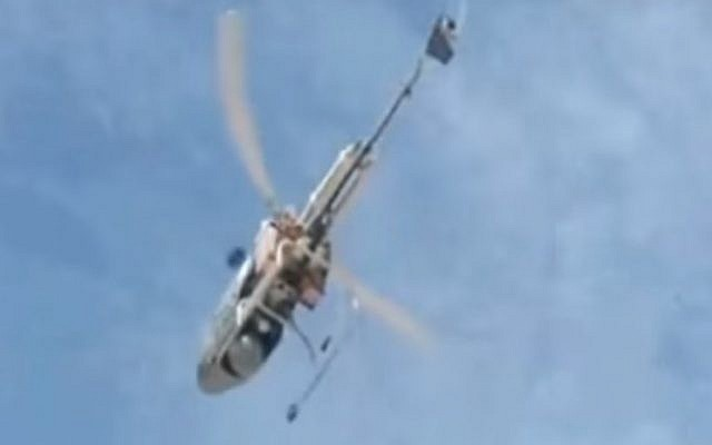 The Volcani Institute research helicopter, gifted by Agriculture Minister Uri Ariel to Russian Prime Minister Dmitri Medvedev on November 10, 2016, seen in action flying over agricultural fields. (YouTube screenshot)