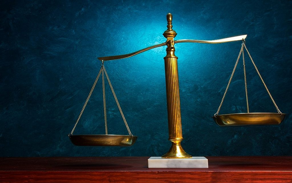Illustrative: Scales of justice (iStock-488361865)