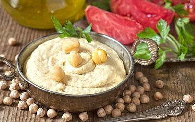 An illustrative plate of hummus (TeodoraDjordjevic/Getty Images)