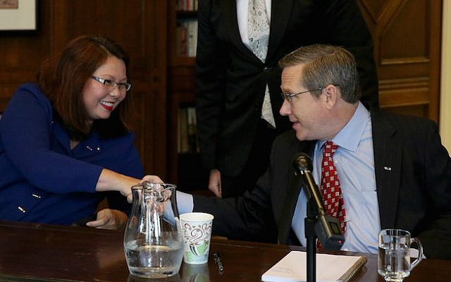 Illinois Senate seat rivals Tammy Duckworth and Mark Kirk shaking hands following their debate at the Chicago Tribune, Oct. 3, 3016. (Nancy Stone/Chicago Tribune/TNS via Getty Images/via JTA)