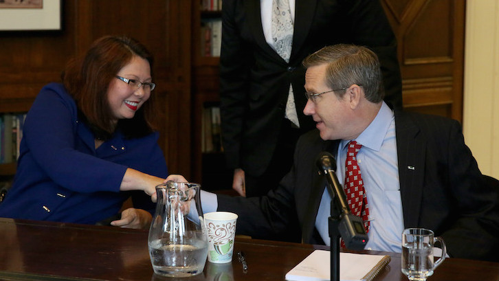 Illinois Senator-Elect Tammy Duckworth (D) shakes hands with Senator Mark Kirk (R) at a debate on October 3, 2016, who she defeated in the 2016 election. (Nancy Stone/Chicago Tribune/TNS via Getty Images/via JTA)