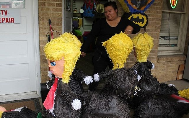 Clinton-voter Amelia De La Cruz at Raquel's Partyland store in Austin, Texas carries Trump piñatas which she says have been major sellers, November 8, 2016. (Ricky Ben-David/Times of Israel)