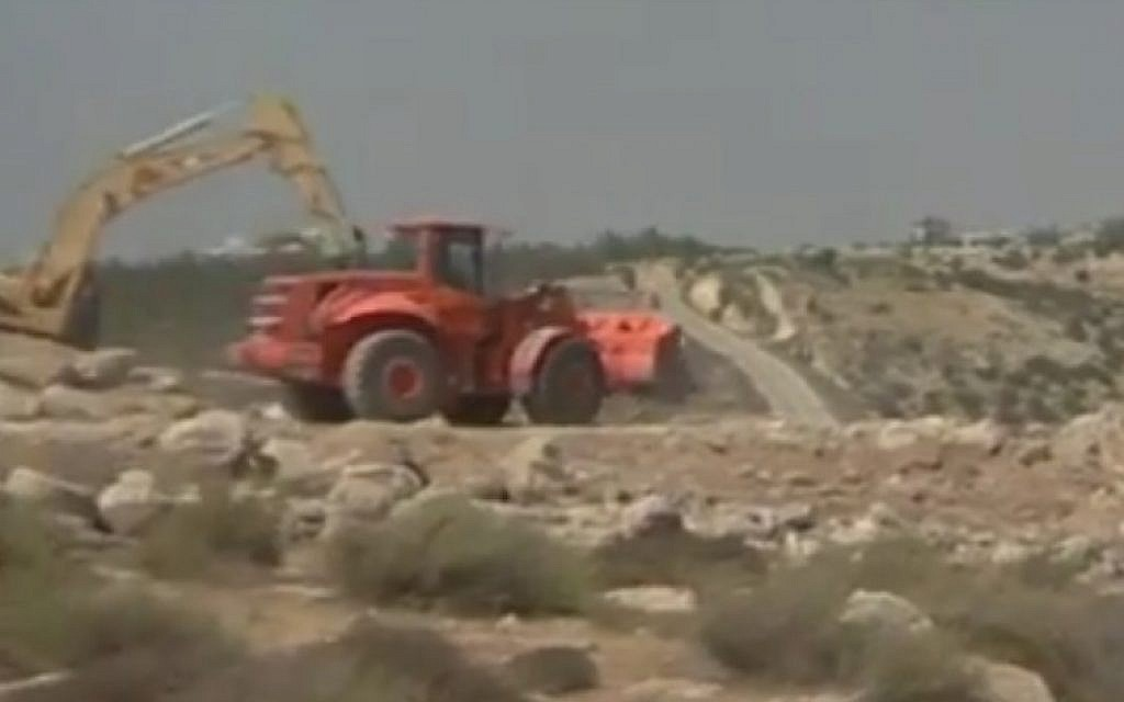 Israel begins construction of a segment of the security barrier in the West Bank (YouTube screenshot)