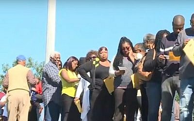 African-American voters cast early ballots in Raleigh, North Carolina as part of the 'Souls to the Polls' drive by black churches, in a still image taken from a CBS video aired on October 25, 2016 (screen capture: YouTube)