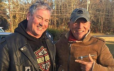 A picture of rocker Bruce Springsteen and biker Dan Barkalow taken November 12, 2016 after the singer got stuck on the side of a New Jersey highway when his motorcycle broke down. (Facebook screen capture)