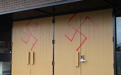 Spray-painted swastikas on the doors of the Machzikei Hadas synagogue in Ottawa, November 2016. (Screenshot)