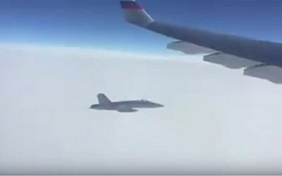 A Swiss fighter jet follows a Russian presidential plane  en route to the APEC summit in Peru on November 18, 2016 (Screen capture: YouTube)