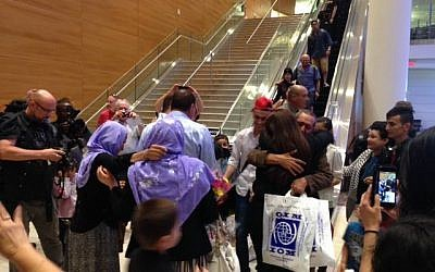"The first privately sponsored Yazidi family arrives in Winnipeg Manitoba, through ""Operation Ezra"" on July 11, 2016. (Michel Aziza)"