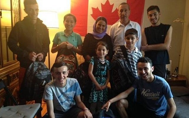 "The first privately sponsored mission called ""Operation Ezra"" brought this Yazidi family to Canada on July 11, 2016. (Courtesy of Michel Aziza)"