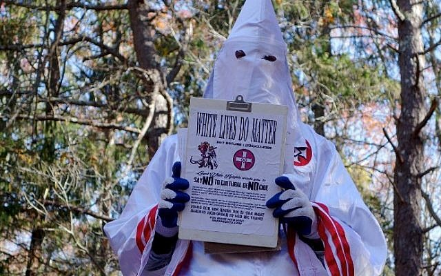 A member of the Ku Klux Klan who says his name is Gary Munker poses for a photo during an interview with AFP in Hampton Bays, New York on November 22, 2016. (AFP/William Edwards)