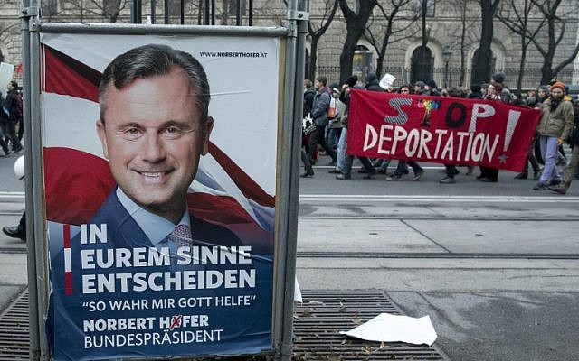 Austrian citizens and asylum seekers march past a poster featuring presidential candidate Norbert Hofer of the Freedom Party, during a pro-refugee protest in Vienna, Austria, November 26, 2016. (AFP Photo/Joe Klamar)