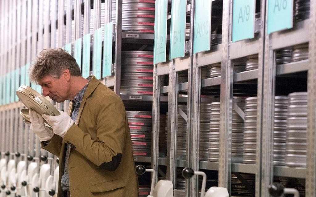 Nikolaus Wostry, head of Film Collections of Filmmarchiv Austria, smells an old film in a special storage at Filmarchive Austria in Laxenburg on November 15, 2016. (AFP PHOTO / JOE KLAMAR)