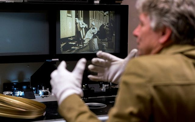 """Nikolaus Wostry, head of Film Collections of Filmmarchiv Austria, shows the movie' """"The City Without Jews""""' at Filmarchive Austria in Laxenburg on November 15, 2016. (AFP PHOTO / JOE KLAMAR)"""
