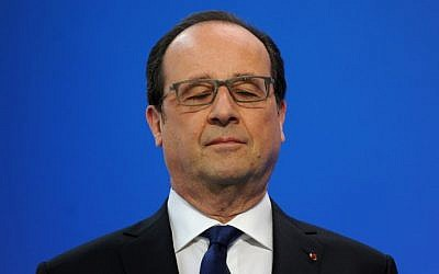 This file photo taken on April 21, 2016 shows French President Francois Hollande blinking before delivering a speech on April 21, 2016. (AFP PHOTO/POOL/GUILLAUME SOUVANT)