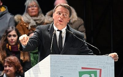 Italy's Prime Minister Matteo Renzi delivers a speech during a campaign meeting on a referendum on constitutional reforms, on December 2, 2016 at Piazza della Signoria in central Florence. (AFP/Claudio Giovannini)