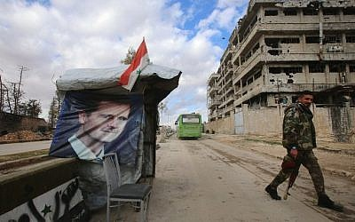 A Syrian pro-government fighter patrols next to a checkpoint in the Shihan neighbourhood in the government-held side of Aleppo, on December 3, 2016. (AFP Photo/Youssef Karwashan)