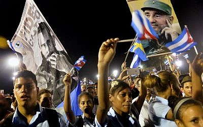 Cubans pay homage to the late leader Fidel Castro during the last ceremony before his burial in Santiago de Cuba, the cradle of his revolution, on December 3, 2016. (AFP/Pedro Pardo)