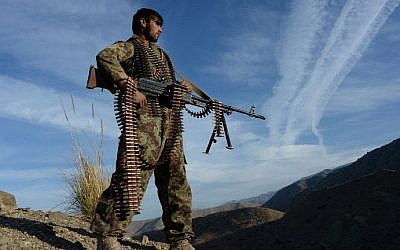In this photograph taken on December 3, 2016, Afghan security force personnel keeps watch following an operation against Islamic State (IS) militants in Pachir Wa Agam district of Nangarhar province. (AFP PHOTO / POOL / NOORULLAH SHIRZADA)