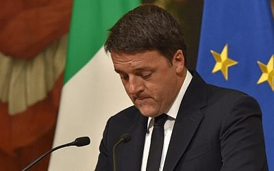 Italy's Prime Minister Matteo Renzi announces his resignation during a press conference at the Palazzo Chigi following the results of the vote for a referendum on constitutional reforms, on December 5, 2016 in Rome. (Andreas Solaro/AFP via Getty Images)