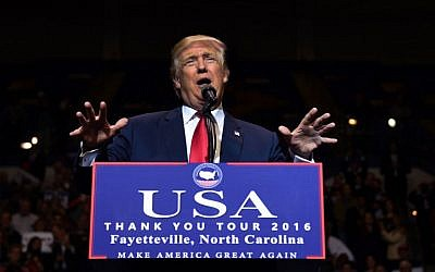 US President-elect Donald Trump speaks at the Crown Coliseum in Fayetteville, North Carolina on December 6, 2016. (AFP/TIMOTHY A. CLARY)