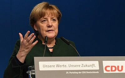 German Chancellor and Head of the Christian Democratic Union (CDU) Angela Merkel delivers a speech during a party's congress in Essen, western Germany, on December 7, 2016. (AFP/Patrik Stollarz)
