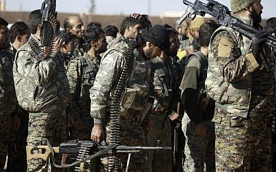 "Fighters from the Kurdish-Arab alliance, known as the Syrian Democratic Forces, prepare for an assault on the Islamic State (IS) bastion of Raqqa on December 10, 2016. (DELIL SOULEIMAN / AFP)      A US-backed alliance of Arab and Kurdish fighters announced ""phase two"" of its campaign for the Islamic State group's Syrian bastion of Raqa.  / AFP PHOTO / DELIL SOULEIMAN"