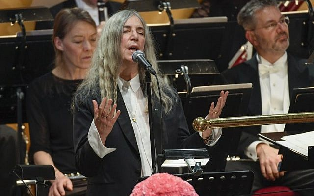 US singer Patti Smith performs 'A Hard Rain's A-Gonna Fall' by absent Literature prize winner Bob Dylan during the awardings of the Nobel Prizes in medicine, economics, physics and chemistry in Stockholm, Sweden on December 10, 2016. (AFP PHOTO/TT News Agency/JESSICA GOW)