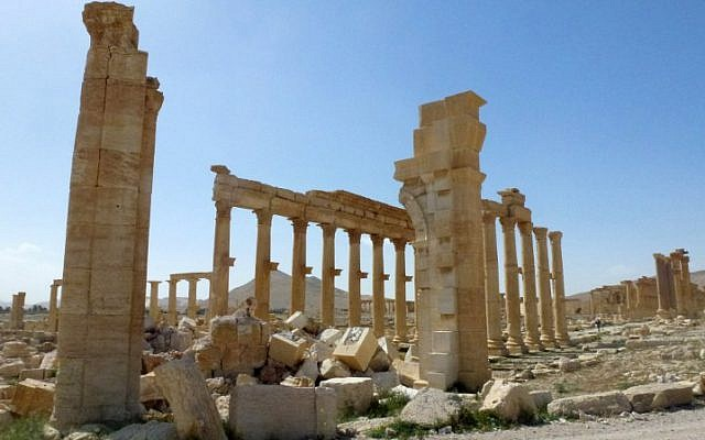 A view of the remains of Arch of Triumph, also called the Monumental Arch of Palmyra, that was destroyed by Islamic State (IS) group jihadists seen here on March 27, 2016. (AFP/Maher AL MOUNES)