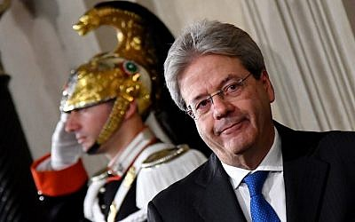 Italy's newly named Prime Minister Paolo Gentiloni arrives for a press conference in Rome on December 11, 2016. ( AFP PHOTO / Alberto PIZZOLI)
