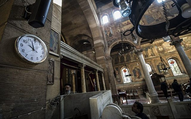 Egyptian security forces and members of the clergy inspect the scene of a bomb explosion at the Saint Peter and Saint Paul Coptic Orthodox Church on December 11, 2016, in Cairo's Abbasiya neighbourhood. (AFP PHOTO / KHALED DESOUKI)