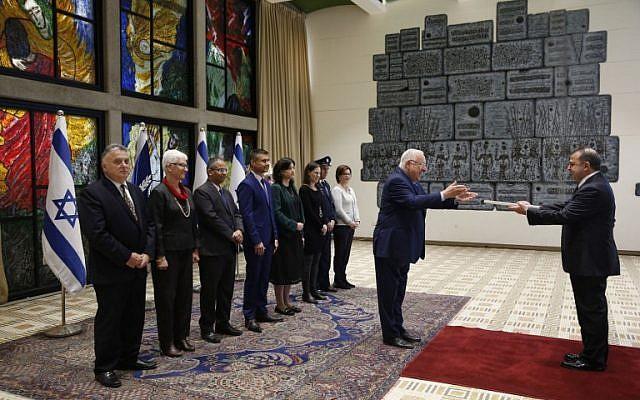 Turkish ambassador to Israel Kemal Okem, right, hands his diplomatic credentials to Israeli President Reuven Rivlin in Jerusalem on December 12, 2016. (AFP/ POOL / RONEN ZVULUN)
