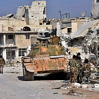 Syrian pro-government forces hold a position in Aleppo's Sheikh Saeed district, on December 12, 2016, after troops retook the area from rebel fighters. (AFP PHOTO / GEORGE OURFALIAN)