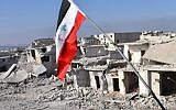 A general view shows destroyed buildings in Aleppo's Sheikh Saeed district, on December 12, 2016, after Syrian pro-government forces retook the area from rebel fighters. (AFP PHOTO / GEORGE OURFALIAN)