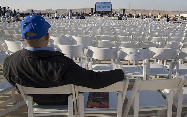 Empty chairs are seen during a ceremony to receive the delivery of two F-35 fighter jets on December 12, 2016, at the Israeli Nevatim Air force base. AFP/JACK GUEZ)