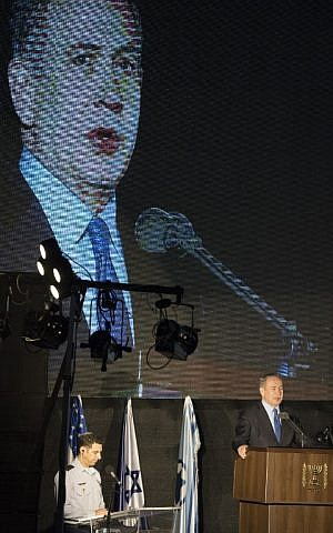 Prime Minister Benjamin Netanyahu gives a speech during a ceremony marking the arrival of the first two F-35 stealth fighter jets purchased from the United States at the Nevatim air base in the Negev desert on December 12, 2016. (Jack Guez/AFP)