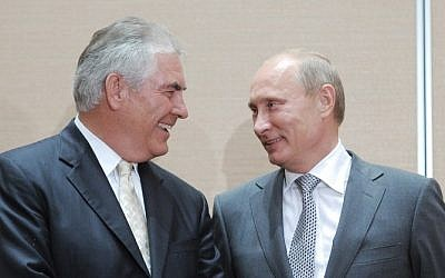 This file photo taken on August 30, 2011 shows  Russia's then Prime Minister Vladimir Putin speaking with ExxonMobil President and CEO Rex Tillerson during the signing of a Rosneft-ExxonMobil strategic partnership agreement in Sochi. (AFP PHOTO/RIA NOVOSTI/ALEXEY DRUZHININ)