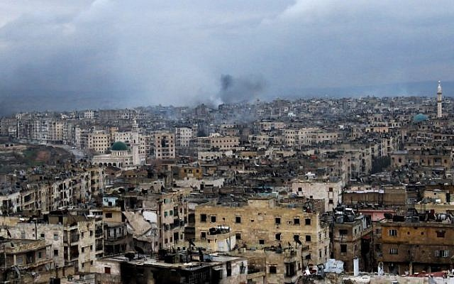A general view shows smoke rising from buildings in Aleppo's southeastern al-Zabdiya neighborhood following government strikes on December 14, 2016. (AFP PHOTO / STRINGER)